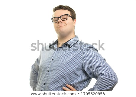 handsome young smart casual man with a smug look stock photo © feedough
