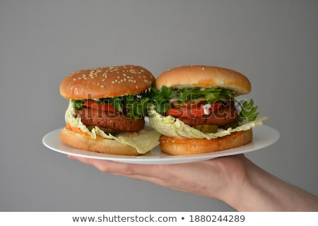 Two tasty grilled home made burgers with beef, tomato, onion and lettuce Stock photo © dash