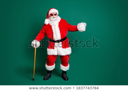 A man in a coat and hat holding a stick in his hands isolated on white background. Vector cartoon cl Stock photo © Lady-Luck