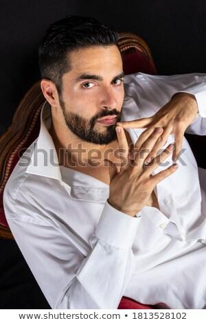 Portret uwodzicielski biznesmen czarny garnitur posiedzenia biały Zdjęcia stock © feedough