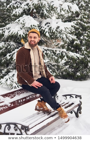 Portrait of a cheerful man dressed in sweater Stock photo © deandrobot