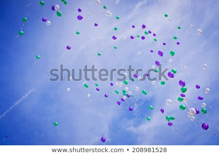 Purple balloon flying on white background Stock photo © colematt