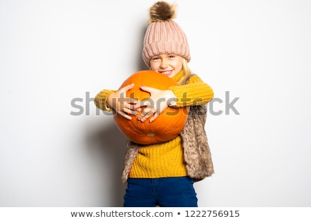 A Cute girl 5 year old posing in studio with pumpkin Stock photo © Lopolo