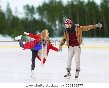 happy couple holding hands on outdoor skating rink Stock photo © dolgachov
