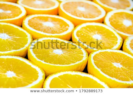 close up of grapefruit orange pomelo and lime stock photo © dolgachov
