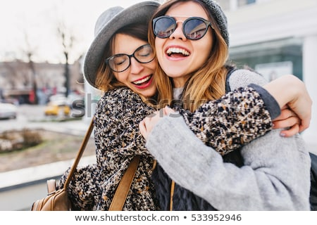 Stok fotoğraf: Young pretty girls best friends smiling and having fun
