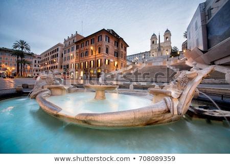 Piazza di Spagna square and Fontana della Barcaccia fountain in  Stock photo © xbrchx
