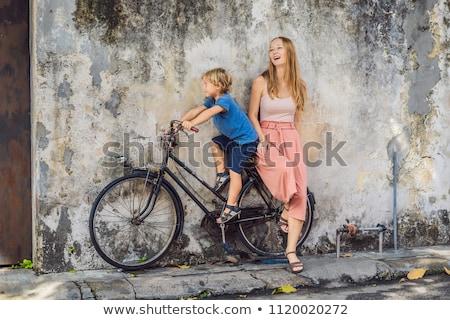 Anya fiú bicikli nyilvános street art név Stock fotó © galitskaya
