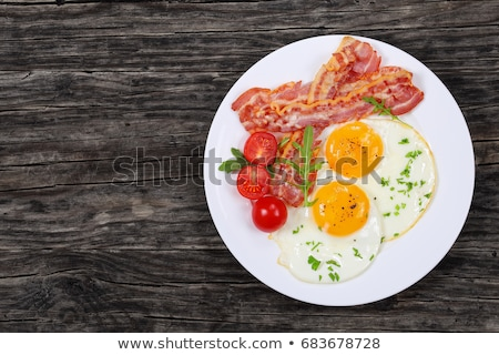 Fried bacon and sunny side up eggs  Stock photo © grafvision