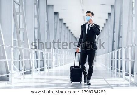 netwerken · luchthaven · vrouwelijke · werknemer · twee · mannen · vergadering - stockfoto © pressmaster