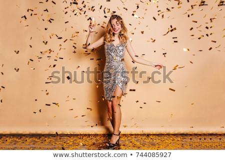 Teljes alakos kép meglepődött boldog szőke nő fürtös Stock fotó © deandrobot