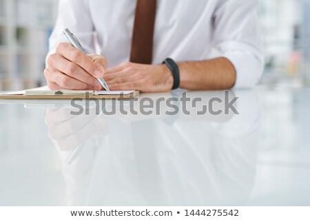 Jonge specialist schrijven beneden werken plan Stockfoto © pressmaster