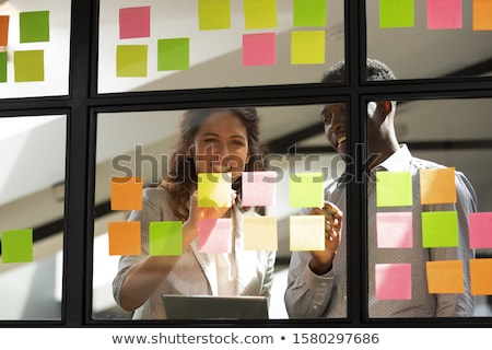 Stock photo: Business team two colleagues discussing working with many docume