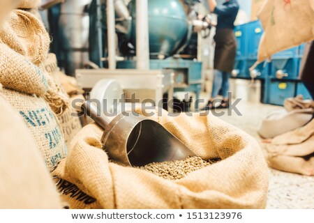 Bags of coffee in roastery or wholesale storage Stock photo © Kzenon