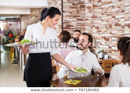 Portré pincérnő tart étel tányér étterem Stock fotó © wavebreak_media