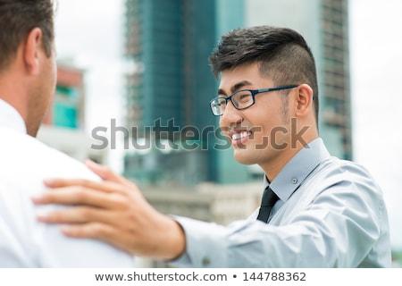 Smiling Boss Congratulating Colleague For His Success Stock photo © AndreyPopov