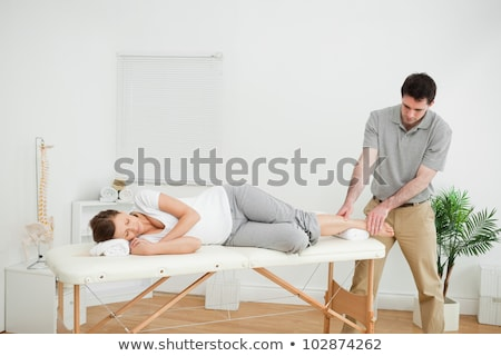 woman lying while being massaged by a man in  room Stock photo © Lopolo
