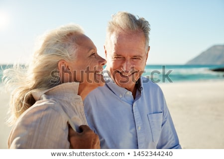 Stockfoto: Side View Of Happy Senior Couple Head To Head On Sunny Day In Garden