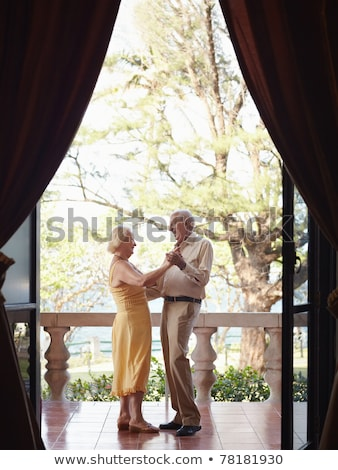 Side view of active senior couple dancing with senior people reading at nursing home Stock photo © wavebreak_media