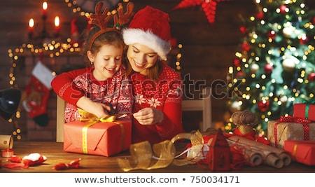 Anne çocuk hediyeler neşeli Noel Stok fotoğraf © choreograph