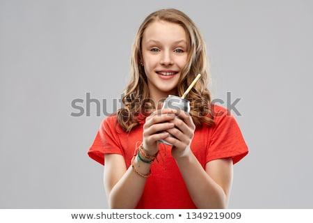 Adolescente peuvent soude papier paille Photo stock © dolgachov
