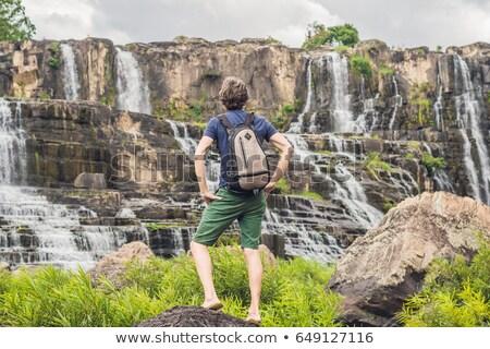 Homem andarilho turista surpreendente cachoeira famoso Foto stock © galitskaya