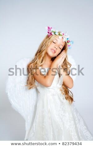 angel children blond girl with sleeping hands gesture stock photo © lunamarina