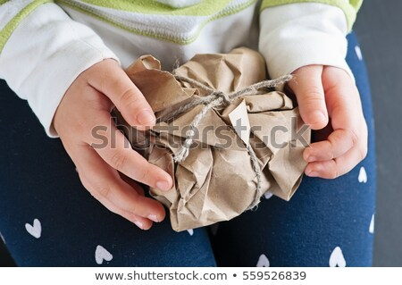 Unwrapping paperbags Stock photo © pressmaster