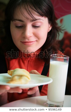 pretty woman with pie on plate and glass of milk Stock photo © Paha_L