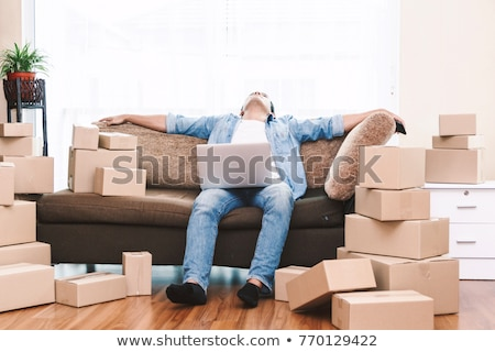 A tired man on moving day Stock photo © photography33