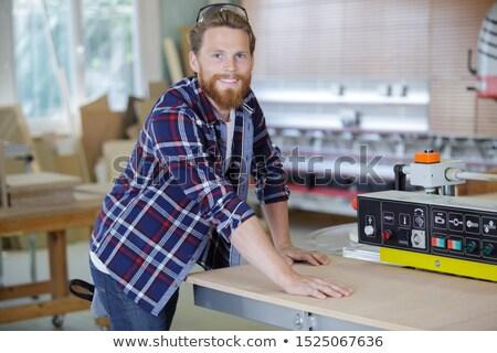 portrait of craftsman holding sander machine Stock photo © photography33