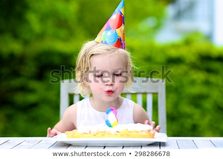kid making faces at a birthday party stock photo © stuartmiles