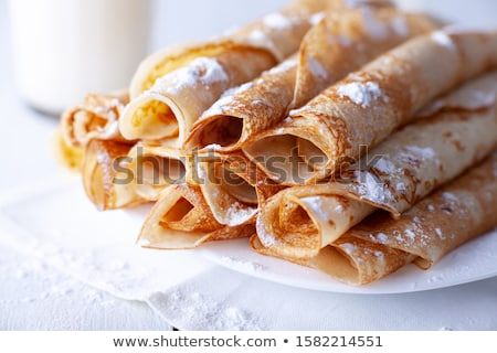 Rolled pancakes with powdered sugar Stock photo © ozaiachin