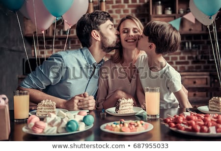 woman blowing birthday candles in family Stock photo © photography33