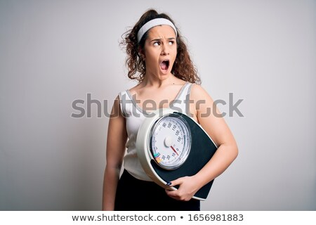 Young woman on a weighing machine Stock photo © grafvision