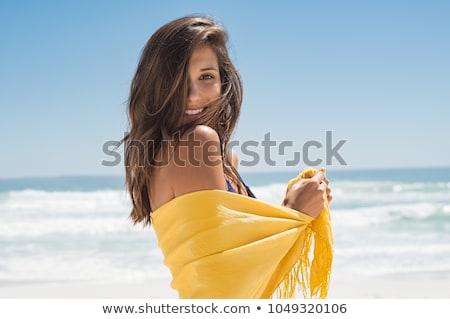 happy woman with yellow sarong on the beach Stock photo © dolgachov