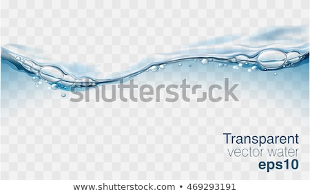 wave in blue water with bubbles stock photo © lightsource