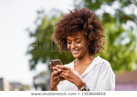 beautiful young woman speaking on cellphone stock photo © pablocalvog