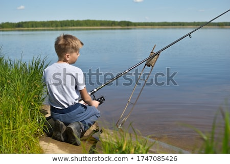 Angler sitting on the shore Stock photo © haraldmuc