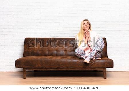 Pretty girl thinking mischievous idea Stock photo © stockyimages