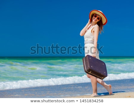 Redhead girl on the beach in spring time. Stock photo © Massonforstock