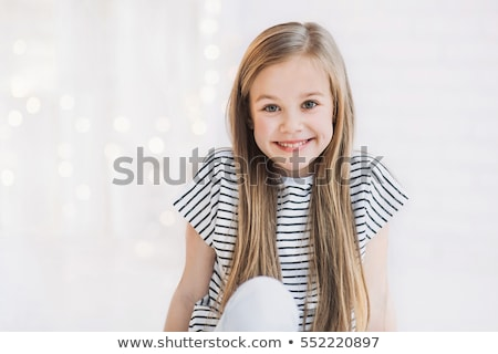 Sweet little girl smiling to camera Stock photo © lunamarina