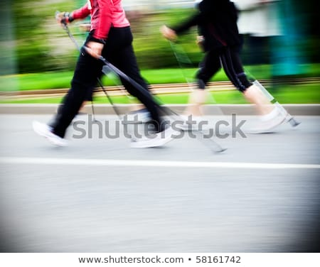Nordic walking sport run walk motion blur outdoor person legs tr Stock photo © fotoaloja
