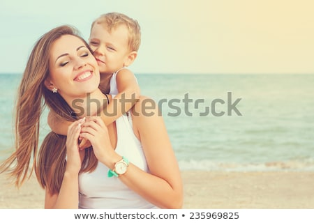 Woman playing with her son on the beach Stock photo © bmonteny