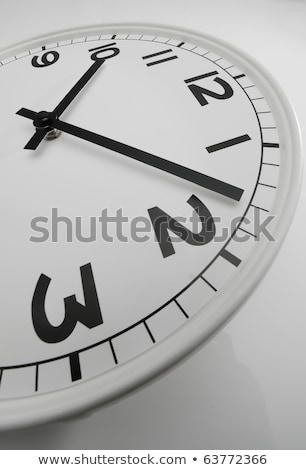 White clock with black hands showing eight past ten stock photo © AlessandroZocc