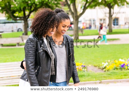 Best friends of North African ethnicity in park Stock photo © Kzenon