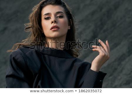 Stunning brunette on the sand Stock photo © acidgrey