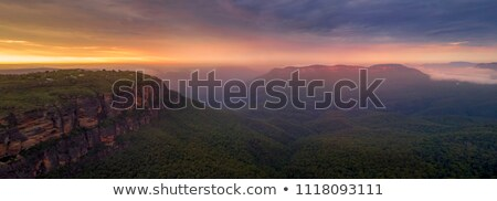 sunrise over jamison valley mt solitary stock photo © lovleah