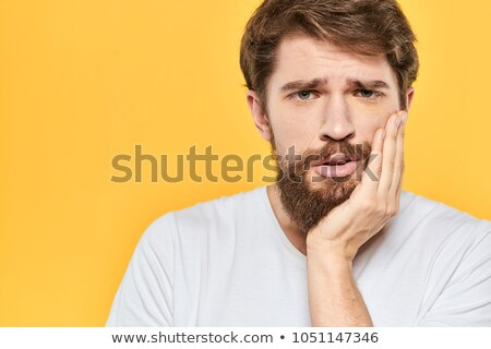 casual man holding his hand to the chin Stock photo © feedough