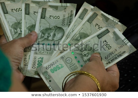 Woman holding Indian paper currency Stock photo © imagedb